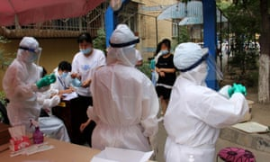 Residents undergo nucleic acid testing during the Covid-19 epidemic on 19 July 2020 in Urumqi, Xinjiang, China.