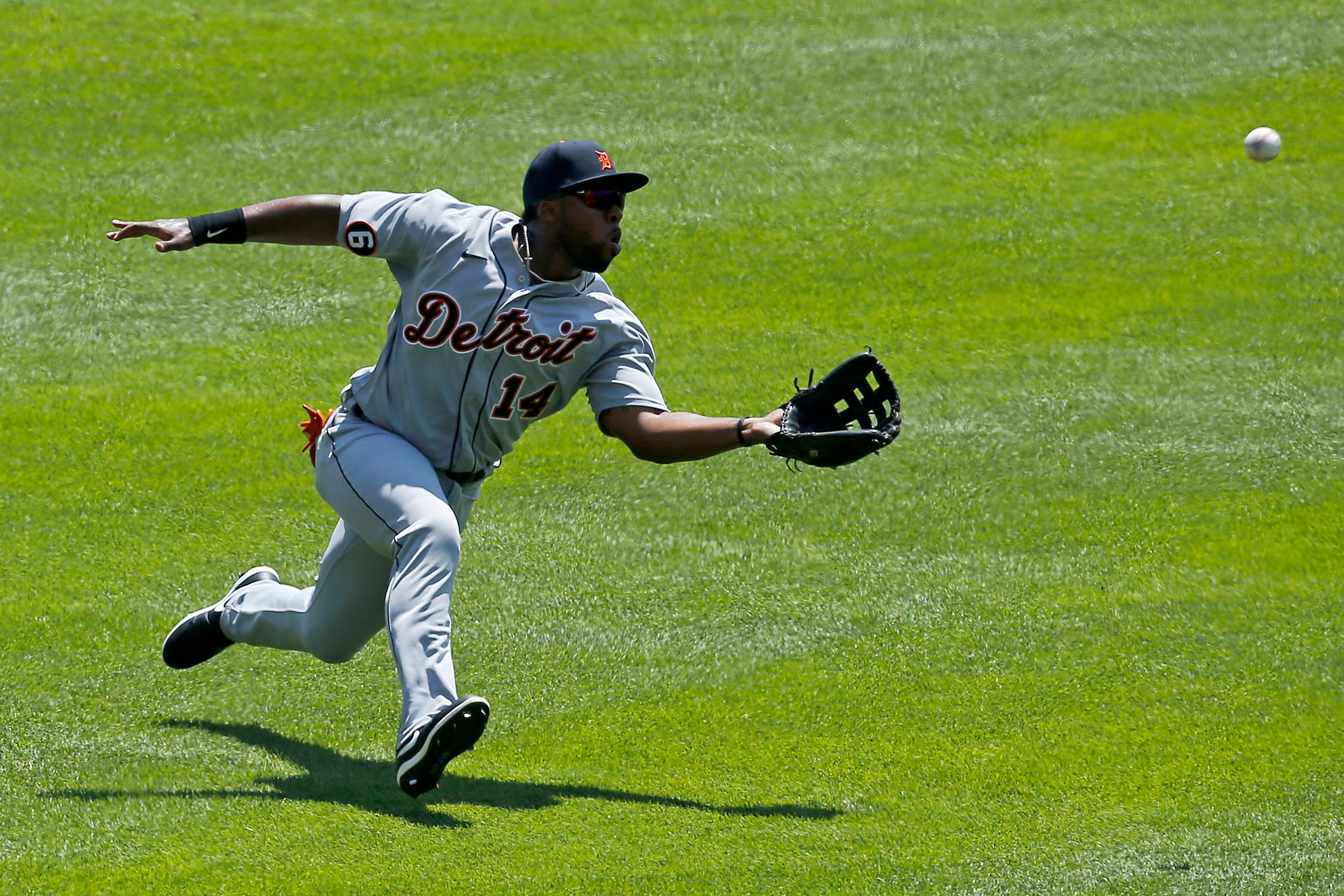 Detroit Tigers left fielder Christin Stewart makes a sliding catch on a line drive off the bat of Cincinnati Reds first baseman Joey Votto in the first inning at Great American Ball Park in Cincinnati on Sunday, July 26, 2020.