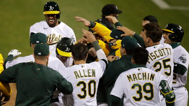 A's slam Angels in first MLB game with new extra-inning rule