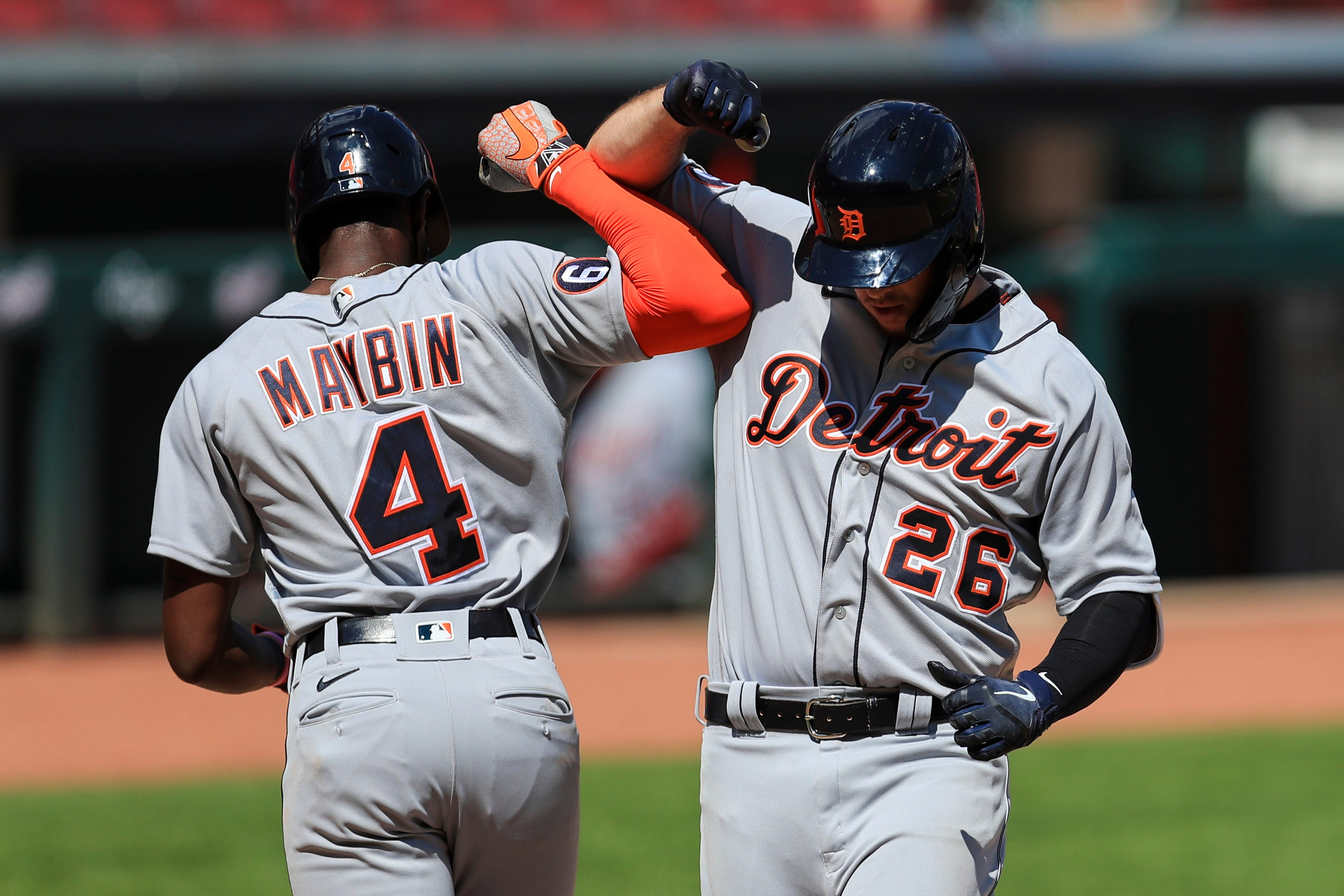 Tigers' C.J. Cron, right, celebrates with Cameron Maybin after hitting a two-run home run in the ninth inning against the Reds at Great American Ballpark on Sunday.