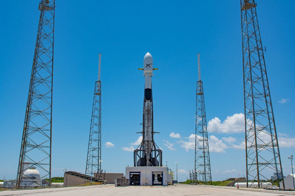 """This files handout photo released by SpaceX on May 16, 2019 shows Falcon 9 ready for the second launch of 60 Starlink satellites from Space Launch Complex 40 at Cape Canaveral Air Force Station in Cape Canaveral, Florida. - SpaceX on July 11, 2020, delayed the launch of a rocket due to take 57 mini-satellites into space as part of plan to build an orbiting, global broadband internet system. The company tweeted that it was postponing the 10th Starlink mission """"to allow more time for checkouts."""" It said it was working to identify a new launch window. (Photo by Handout / SPACEX / AFP) / RESTRICTED TO EDITORIAL USE - MANDATORY CREDIT """"AFP PHOTO / SPACEX """" - NO MARKETING NO ADVERTISING CAMPAIGNS - DISTRIBUTED AS A SERVICE TO CLIENTS"""