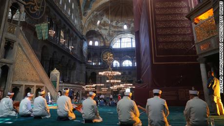 Worshipers join a prayer program at Hagia Sophia ahead of the first Friday prayers there in 86 years.